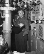Rear Admiral Burke aboard a submarine in the early 1950s