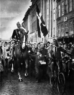 King Christian X of Denmark riding through Copenhagen on his 70th birthday, 26 Sep 1940