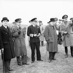 Lord Cherwell, Charles Portal, Dudley Pound, Winston Churchill, and others observing anti-aircraft gunnery in Britain, Jun 1941