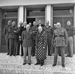 Dwight Eisenhower and Winston Churchill in Tunisia, 25 Dec 1943, photo 1 of 2; Churchill was in a robe in this photo because he was recovering from pneumonia