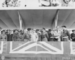 Bernard Montgomery, Winston Churchill, Harold Alexander, and Anthony Eden at the Charlottenberger Chausce reviewing stand during the Berlin victory parade, Germany, 21 Jul 1945