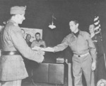 Generalleutnant Fridolin von Senger und Etterlin surrendering to General Mark Clark at US 15th Army Group Headquarters, Italy, 4 May 1945