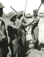 US 5th Army Lieutenant General Mark Clark pinning Presidential Distinguished Unit Citation ribbons to Japanese-American members of 100th Infantry Battalion, Vada area, Italy, 27 Jul 1944