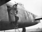 Prime Minister John Curtin exiting from Lancaster bomber