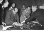 French Prime Minister Daladier signing the Munich Agreement, 30 Sep 1938; note Galeazzo Ciano in background and Joachim von RIbbentrop pointing