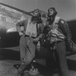 Colonel Benjamin Davis, Jr. and Captain Edward Gleed standing in front of fellow African-American pilot Lieutenant White