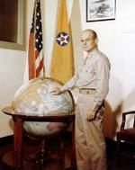 Brigadier General Doolittle posing with a globe, circa 1942
