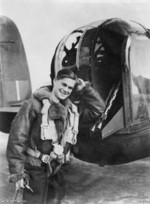 RAAF Flight Sergeant Roberts Dunstan posing outside of a tail gun position of a Lancaster bomber, Britain, 9 Sep 1943