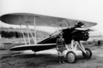 Ira Eaker with a P-12 fighter aircraft, 1930s