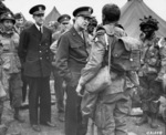 General Dwight Eisenhower speaking to airborne troops, England, United Kingdom, 5 Jun 1944; note Major General Ray Barker in background