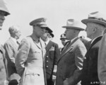 US Army General Dwight Eisenhower and US President Harry Truman at Brussels, Belgium, en route to the Potsdam Conference, 15 Jul 1945; note US Ambassador to Belgium Charles Sawyer and US Secretary of State James Byrnes in background