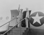 General Dwight Eisenhower waving to a crowd while boarding an aircraft, Washington National Airport, Arlington, Virginia, United States, 18 Jun 1945; note his son John Eisenhower
