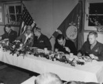 Eleanor Roosevelt and Major General Julian Smith at a dinner with US 2nd Marine Division officers, New Zealand, Aug-Sep 1943