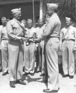 A flag previously raised on Iwo Jima, Japan was presented to Major General Graves Erskine for use in the filming of the movie Sands of Iwo Jima, 14 Jul 1949