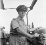 Commander Harold Farncomb at the bridge of cruiser HMAS Shropshire, 3 Jul 1945