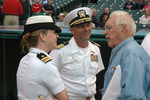 Bob Feller speaking with Lieutenant Commander Elizabeth Zimmermann and Captain Frank McCulloch, Jacob Field, Cleveland, Ohio, United States, 30 Aug 2006