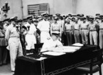 Admiral Sir Bruce Fraser signing the surrender instrument on behalf of the United Kingdom aboard USS Missouri, Tokyo Bay, Japan, 2 Sep 1945, photo 1 of 3