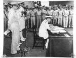 Admiral Sir Bruce Fraser signing the surrender instrument on behalf of the United Kingdom aboard USS Missouri, Tokyo Bay, Japan, 2 Sep 1945, photo 2 of 3