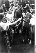 Frick being welcomed by a crowd, Sudetenland, Czechoslovakia, 23 Sep 1938, photo 1 of 3
