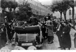 Wilhelm Frick, in a convertible, waving to the crowd, Sudetenland, Czechoslovakia, 23 Sep 1938, photo 2 of 2
