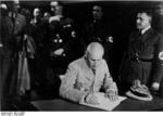 Frick signing a document, Sudetenland, Czechoslovakia, 23 Sep 1938
