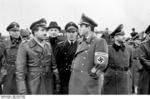 German leaders Albert Speer and Adolf Galland at a conference, possibly reviewing a new aircraft, Germany, 5-7 Sep 1943