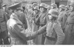 Joseph Goebbels shaking hands with Hitler Youth member Willi Hübner, who had just received the Iron Cross 2nd Class medal for bravery in combat, East Prussia, Germany, 9 Mar 1945