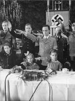 Joseph Goebbels with daughters Helga and Hilde at a large Christmas party amidst the playing of a patriotic song, 23 Dec 1937
