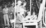 Admiral William Halsey, Major General Robert Beightler, Major General Roy Geiger, and others studying a map at US 37th Division command post on Bougainville, Solomon Islands, Nov-Dec 1943