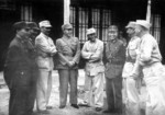Wang Yaowu, Lu Han, Zhang Fakui, He Yingqin, Tang Enbo, Du Yuming, Xiao Yisu, and an unidentified high ranking US Army officer after the surrender ceremony in Zhijiang, Hunan Province, China, 21 Aug 1945