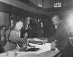 Yasuji Okamura surrendering to He Yingqin, Nanjing, China, 9 Sep 1945, photo 3 of 3