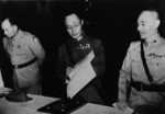 He Yingqin inspecting the Japanese surrender document at the Chinese Military Academy in Nanjing, China, 9 Sep 1945; note US representative General Megrow and General Gu Zuodong