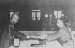 Yasuji Okamura surrendering to He Yingqin, Nanjing, China, 9 Sep 1945, photo 1 of 3
