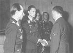 German pilots Hartmann Grasser, Heinrich Prinz zu Sayn-Wittgenstein (shaking hands with Hitler), Günther Rall, and Walter Nowotny with Adolf Hitler at Wolfsschanze, East Prussia, Germany, 22 Sep 1943