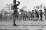 Major General Edmund Herring inspecting troops of Australian 6th Division, Darwin, Australia, 1942