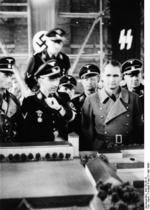 SS-Reichsf?hrer Heinrich Himmler and Rudolf He? viewing a model of the Dachau Concentration Camp, Dachau, Germany, 8 May 1936
