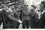 Heinrich Himmler meeting a man at the rank of SS-Obersturmführer, Mauthausen Concentration Camp, Austria, 27 Apr 1941
