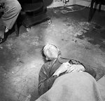 The body of Heinrich Himmler lying on the floor at British 2nd Army HQ after his suicide on 23 May 1945
