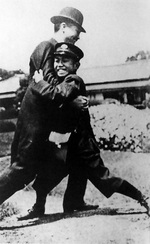 Young Prince Hirohito of Japan wrestling with a servant, 1913
