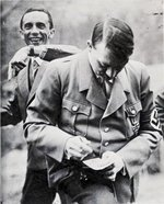 Adolf Hitler and Joseph Goebbels signing autographs, date unknown