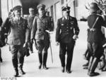 Chancellor Hitler, General Witzleben of German III Corps, and SS-Obergruppenf?hrer Dietrich leaving the 300m freestyle swimming event of the 1936 Summer Olympic Games, Berlin, Germany, 5 Aug 1936