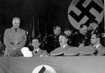 Joseph Goebbels and Adolf Hitler at a party, Berlin, Germany, 30 Oct 1936; note Josef Dietrich in background