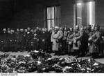 German leaders at Berlin Heroes Memorial, Germany, 25 Feb 1934; L to R: Neurath, Graf Schwerin-Krosigk, Lippert, Frick, Schmidt, Raeder, Hitler, Papen, Goebbels, Hindenburg, Göring, Blomberg, Fritsch