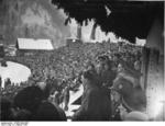Chancellor Hitler speaking at the opening ceremony of IV Olympic Winter Games, Garmisch-Partenkirchen, Bavaria, Germany, 6 Feb 1936; note Heß behind Hitler