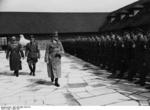 Hitler visiting the Ordensburg Vogelsang school in North Rhine-Westphalia, Germany, 29 Apr 1937, photo 2 of 2; Dr. Robert Ley seen with Hitler