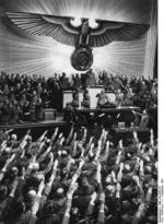 Adolf Hitler receiving salutes from the German Reichstag upon declaring war on the United States, Kroll Opera House, Berlin, Germany, 11 Dec 1941