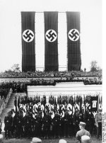 Nazi Party honor guard standing before the rostrum on which Adolf Hitler was addressing a rally, Nürnberg, Germany, 30 Aug-3 Sep 1933