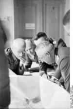 German Army Colonel General Hermann Hoth and Field Marshal Erich von Manstein studying a map during the Battle of Kursk, Russia, Jul 1943
