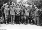 Adolf Hitler with his staff including Keitel, Jodl, Bormann, and others at Wolf