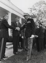 Louis Wilson, Jr. (right) shaking hands with USMC Commandant David Shoup, both Medal of Honor recipients, in the presence of President John Kennedy, White House, Washington DC, United States, circa 1962